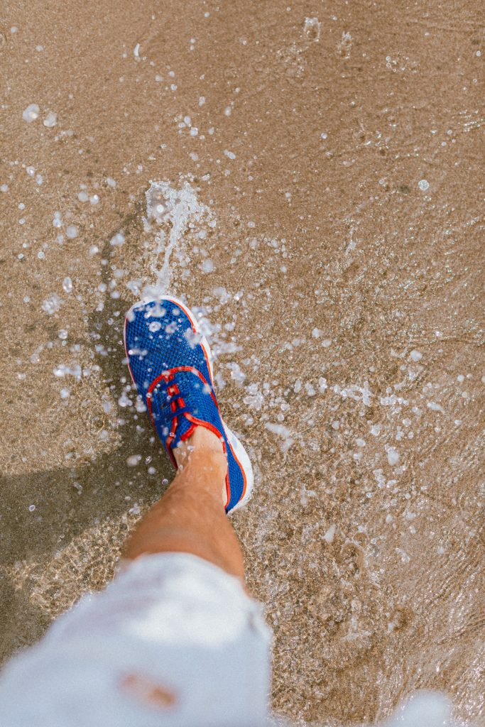 Water splashes from walking at the beach